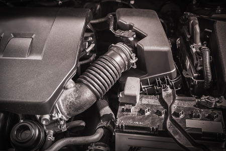 engine compartment: Closeup compartment of car engine under hood background