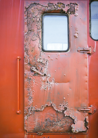 deteriorate: Old red car door and rusty texture background