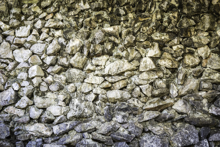 Closeup texture and pattern of rock wall background Stock Photo