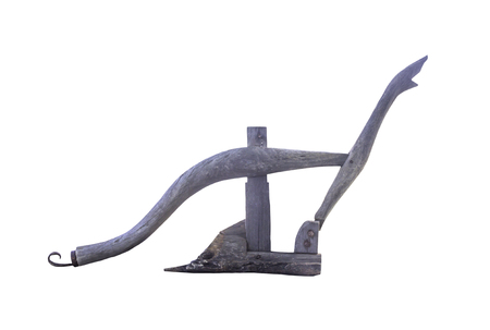 Ancient wooden plough handle isolated on white