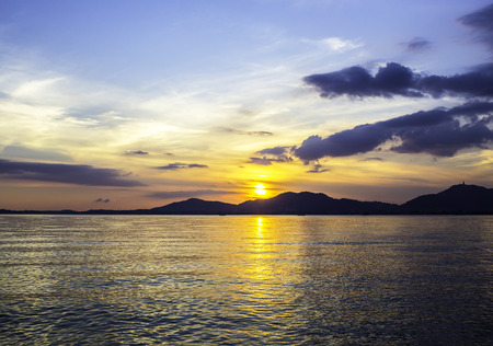 Beautiful sunset with mountain on seascape Stock Photo