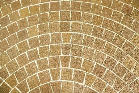 Close up circular brown brick paving pattern Stock Photo