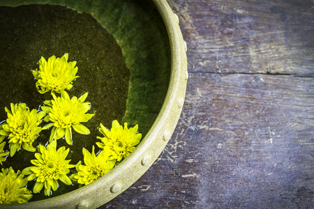 Spa therapy with yellow flowers on  water in bowl Stock Photo