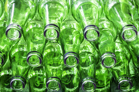 Closeup stack of green color bottles background Stock Photo