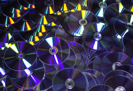 Closeup stack of cd and dvd background
