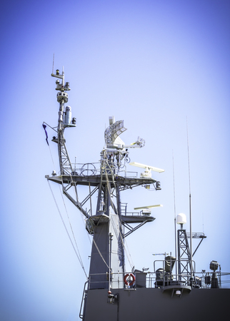 Radar on battleship and blue sky background Stock Photo