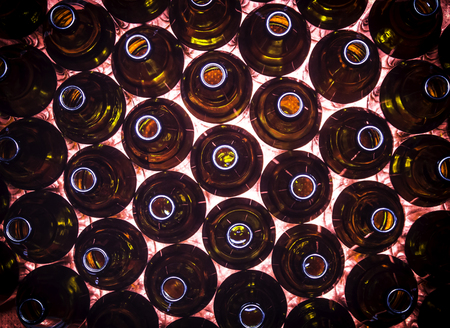 Closeup circular rows of brown color bottles background