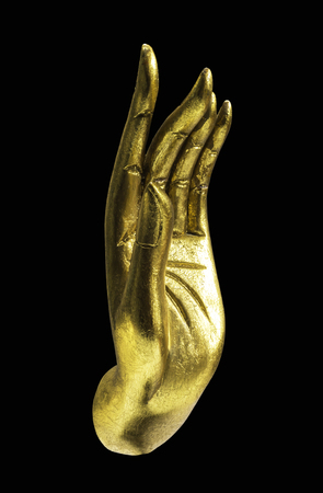 Golden Buddha hand isolated on black with clipping path Stock Photo