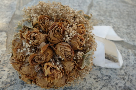 dried flower arrangement: dried roses bridal bouquet remembering a wonderful day Stock Photo