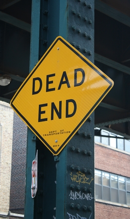 A yello sign at the end of a street in New York