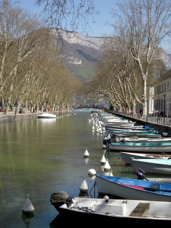 romatic: A romatic view of a canal in Annecy full of boats lined up