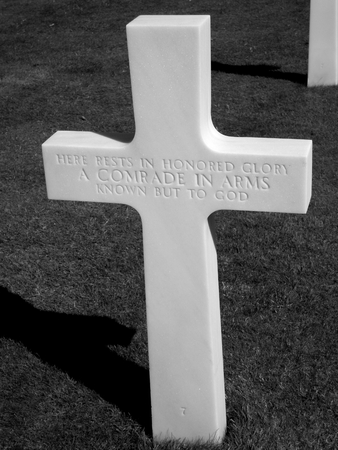 omaha: White cross in the American cemetery at Omaha Beach, Normandy Editorial