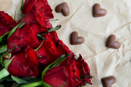 dark red: Dark Red Roses and Chocolate Hearts on Paper