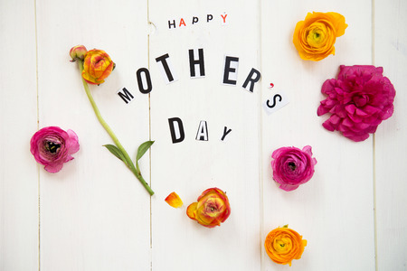 mothers day: Happy Mothers Day Letters cut out from the Magazines and Flowers Ranunculus