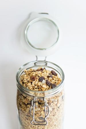 musli: Homemade granola or musli in open glass jar