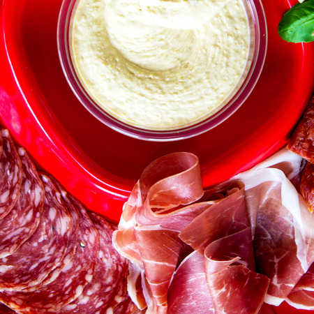 salami slices: Snacks on the Red Plate, Hummus, Red Leicester Cheese, Cheddar Cheese, Emmental Cheese, Basil, Prosciutto, Salami Slices