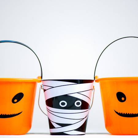 Child Trick or Treat Empty Halloween Buckets are Ready for the Candy Treats, Pumpkin and Mummy Style Stock Photo
