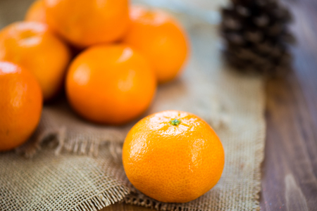 clementine: Fresh Clementine Tangerine on Brown Wooden Table