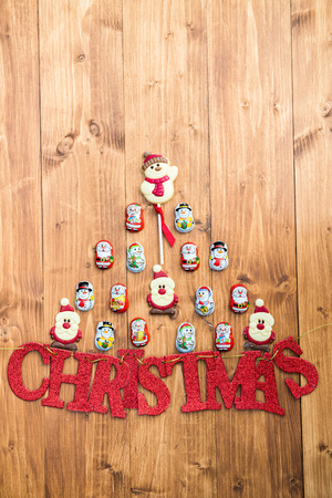 sweettooth: Chocolate Santas, Snowman and Biscuits in a form of Xmas Tree and Red Glittering Letters Christmas