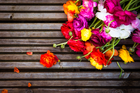 persian buttercup: Bouquet of colorful persian buttercup flowers ranunculus on Wooden Rustic Background, Toned Image