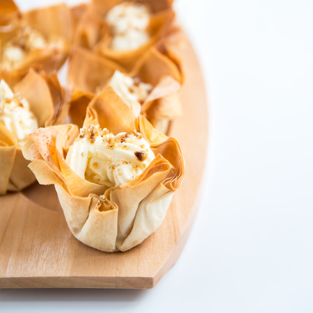 filo: Homemade Filo Pastry Baskets with Mascarpone Cream, White Background, Space for text