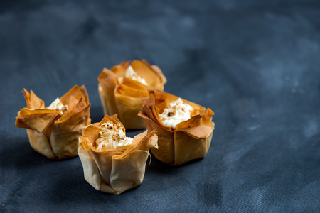 filo: Homemade Filo Pastry Baskets with Mascarpone Cream, Dark Background, Space for text