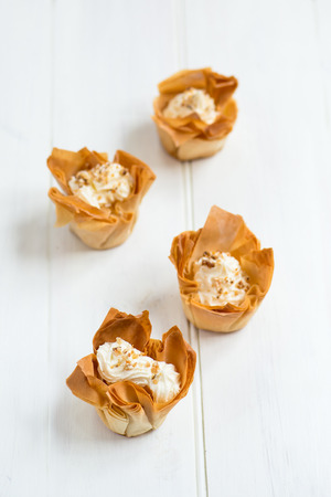 mascarpone: Homemade Filo Pastry Baskets with Mascarpone Cream, White Background