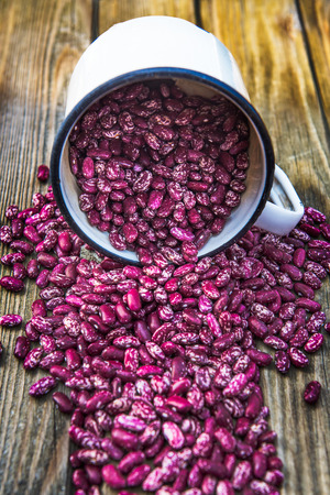 Organic Healthy Red Kidney Speckled Beans in a Pot on Rustic Background, shallow DOF Stock Photo