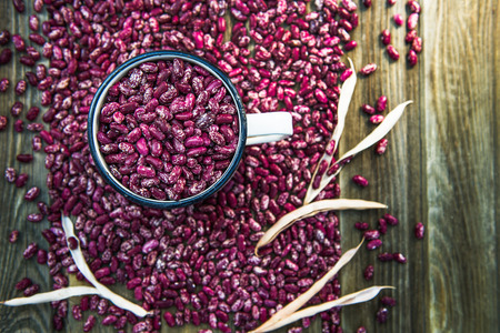 speckle: Organic Healthy Red Kidney Speckled Beans in a Pot on Rustic Background, shallow DOF Stock Photo