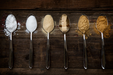 caster: Different Kinds of Sugar in the Spoons, such as coconut sugar, pure cane sugar, icing sugar, agave syrup, dark brown soft sugar, golden caster sugar, demerara cubes