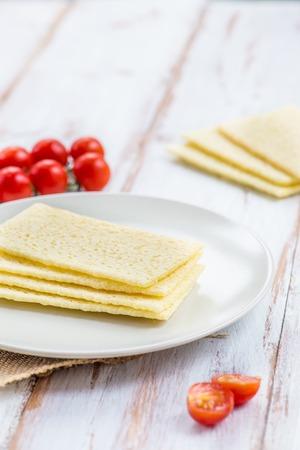Healthy Gluten Free Crispbreads on the Plate, Light Background Stock Photo