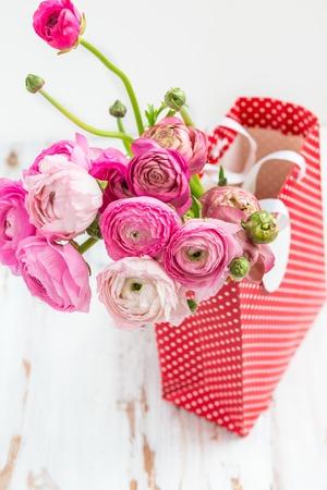 Bunch of pink ranunculus buttercup flowers in a paper bag for bunch of pink ranunculus buttercup flowers in a paper bag for presents white background stock mightylinksfo