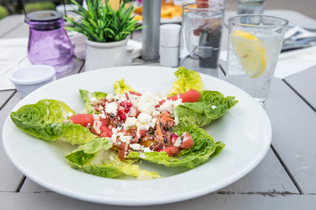 rocket lettuce: Delicious Salad from Quinoa, Black Barley, Watermelon, Pomegranate Seeds and Feta, served in the Pub or Restaurant