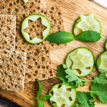Ingredients for Healthy Snack from Wholegrain Rye Crispbread Crackers, Ricotta Cheese and Pieces of Cucumber on the Light Background Stock Photo