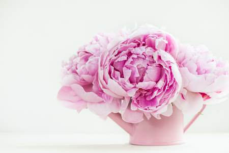Fresh bunch of pink peonies on light background. Card Concept, copy space for text Stock fotó