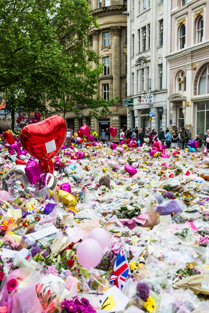 MANCHESTER, ENGLAND - 28 MAY, 2017: Flowers, Balloons and Toys on St Anns Square im Manchester as a tribute to the victims of the Manchester Arena Attack