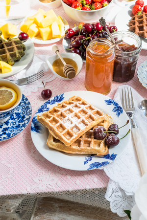 marmelade: Table Set for Breakfast with different kinds of Healthy Waffles, Jams and Berries