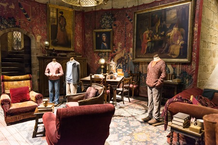 LEAVESDEN, UK - MARCH 24th 2017: The set of Gryffindor common room, with costumes worn by the cast at Hogwarts. The set is located at the Warner Brothers studio and can be visited during the Making of Harry Potter tour. The studio is near London in Leaves