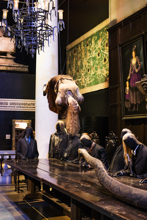 LEAVESDEN, UK - MARCH 24th 2017: The set of Levitating Charity Burbage with Lord Voldemort and Death Eaters around the table at Malfoy Manor. The set is located at the Warner Brothers studio and can be visited during the Making of Harry Potter tour. The s