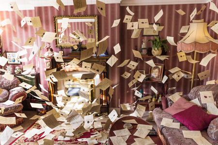 LEAVESDEN, UK - MARCH 24th 2017: The set of the living room at 4 Privet Drive with flying letters. The room is located at the Warner Brothers studio and can be visited during the Making of Harry Potter tour. The studio is near London in Leavesden, UK