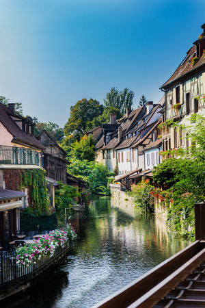 typical: Colorful traditional french houses on the side of river Lauch in Petite Venise, Colmar, Alsace, France