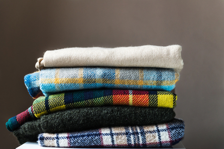 Stack of woolen checked blankets, autumn and winter concept Reklamní fotografie - 88472783