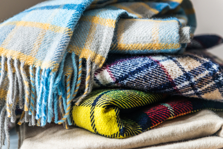 Stack of woolen checked blankets, autumn and winter concept Stock fotó - 90547555