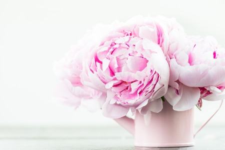 Fresh bunch of pink peonies on light background. Card Concept, copy space for text Stock Photo