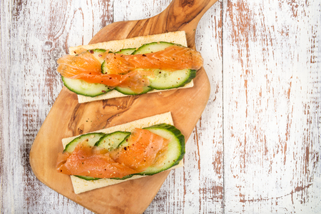 Healthy Snack from Gluten Free Crispbread, Cucumber Slices and Smoked Salmon Reklamní fotografie