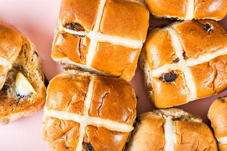 Several Easter Hot Cross Buns on Pink Background, Top View