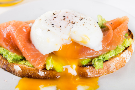 Healthy Breakfast with Wholemeal Bread Toast, smashed Avocado, Salmon and Poached Egg