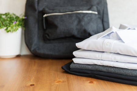 Back to school concept, backpack, school uniform such as white shirts, sweater and trousers on the light background