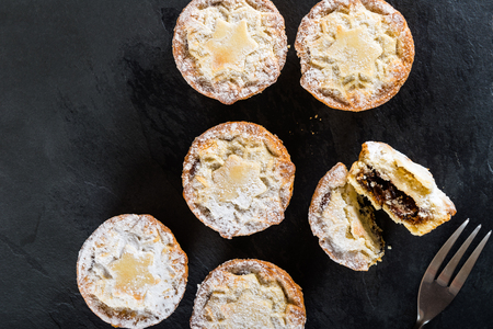 Mince pies, traditional christmas food made from all butter shortcrust pastry pies deep filled with plump vine fruits, such as cranberries, clementine, cherries and brandy Stock Photo