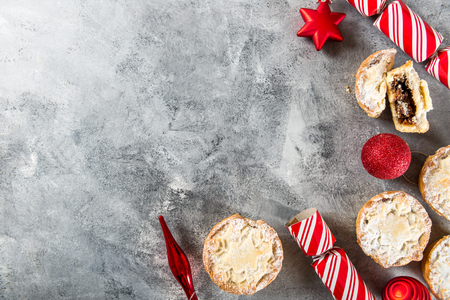 Mince pies, traditional christmas food made from all butter shortcrust pastry pies deep filled with plump vine fruits, such as cranberries, clementine, cherries and brandy, flat lay Stock Photo